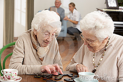 Two Senior Women Playing Dominoes