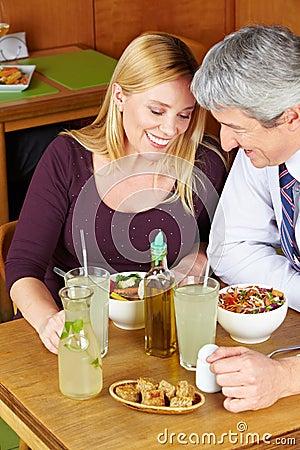 Two seniors having dinner