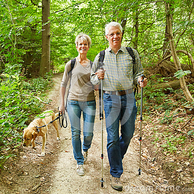 Free Two Seniors Walking With Dog In Forest Royalty Free Stock Image - 58520096