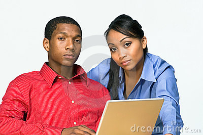 Two Serious Teens With Laptop-Horizontal