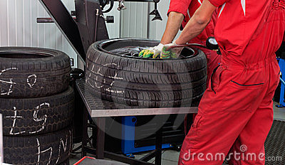 Two servicemans repairing tyre