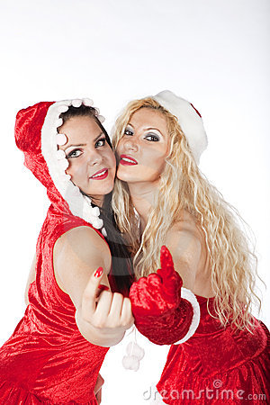 Two sexy Santa girls having fun