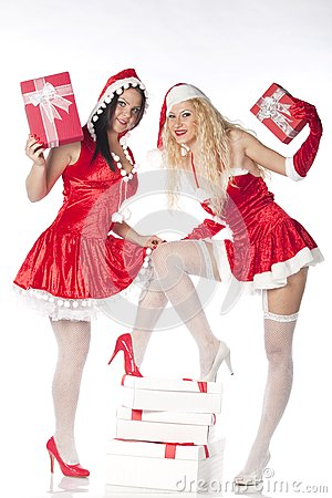 Two sexy Santa girls having fun