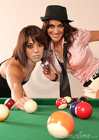 Two sexy woman playing pool