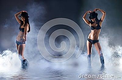 Two sexy women in dark erotic lingerie