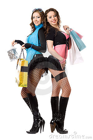Two sexy young women after shopping