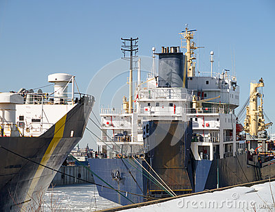Two ships at dock winter time.