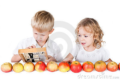 Two siblings counting apples  on whit