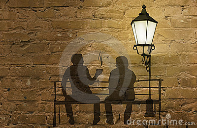 Two silhouettes on a bench