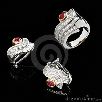 Free Two Silver Earrings And Ruby Ring Royalty Free Stock Images - 12095669