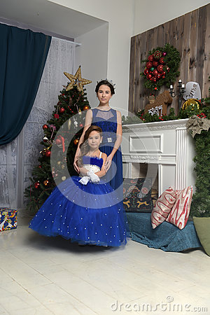 Free Two Sisters At The Christmas Tree Royalty Free Stock Photo - 85476875
