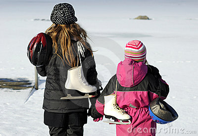 Two sisters are going to ice - skating.