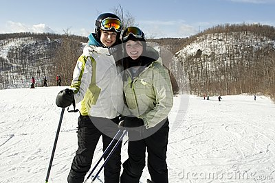 Two sisters happy to be on ski slopes
