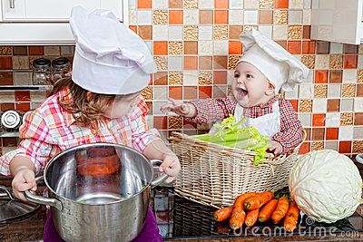 Two sisters play cooks