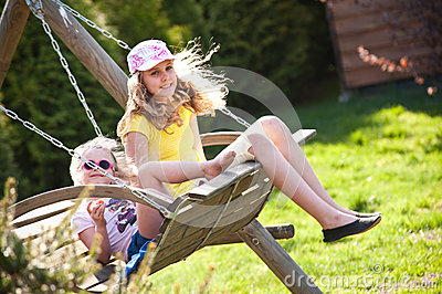 Two sisters on swing