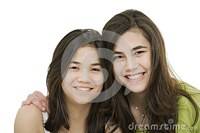 Two sisters together, isolated on white