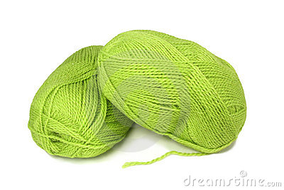 Two skeins of green wool yarn.