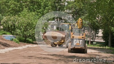 Two skid steer loaders moving sand soil at construction area outdoors stock video