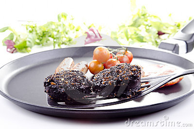 Two slices of black pudding