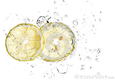 Two slices of lemon in a water splash isolated