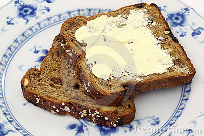 Two slices of wholemeal bread and one buttered