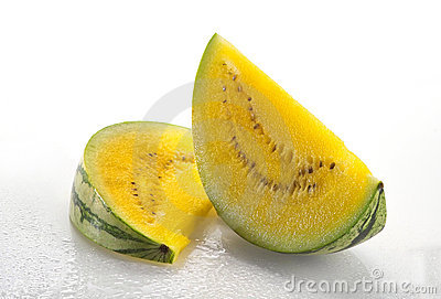 Two slices of yellow watermelon