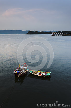Two Small Boats and Public Pier in Calm Sea