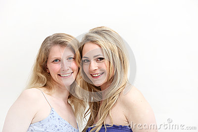 Two smiling blonde women