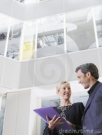 Free Two Smiling Business People With Folder In Office Royalty Free Stock Photography - 33893157