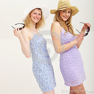 Two smiling friends in summer outfits