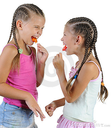 Two smiling girls with candy.