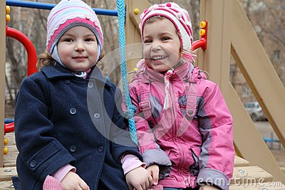 Two smiling girls on playground