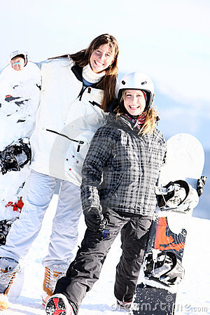 Two smiling girls with snowboards