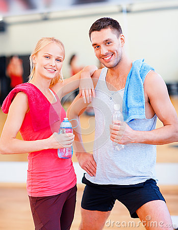 Two smiling people in the gym