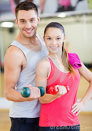 Free Two Smiling People Working Out With Dumbbells Royalty Free Stock Images - 35509769
