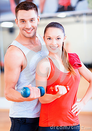 Free Two Smiling People Working Out With Dumbbells Royalty Free Stock Photography - 43044887