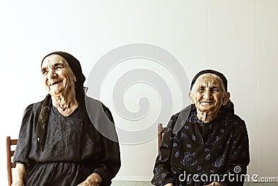 Two smiling senior women