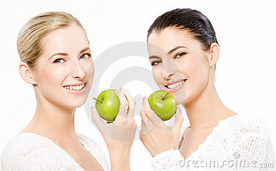 Two smiling women with apples