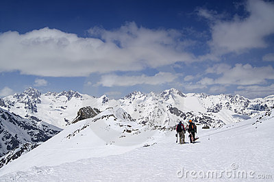 Two snowboarders on the ski resort