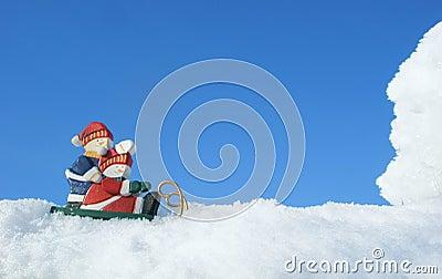 Two snowmen on sledge