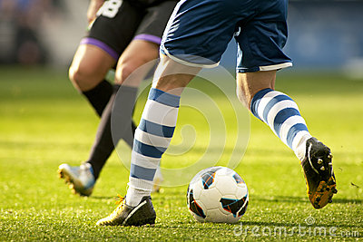 Two soccer players vie