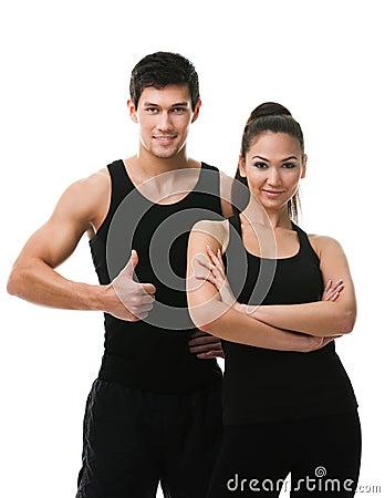 Two sportive people in black sports wear
