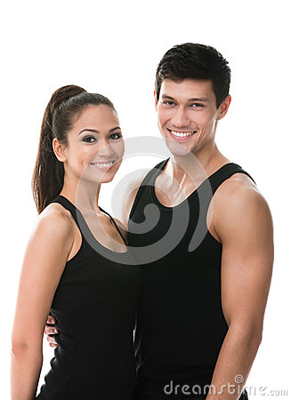 Two sportive people in black sportswear embrace