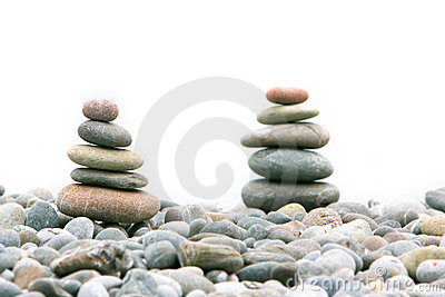 Two stacks of stones over white