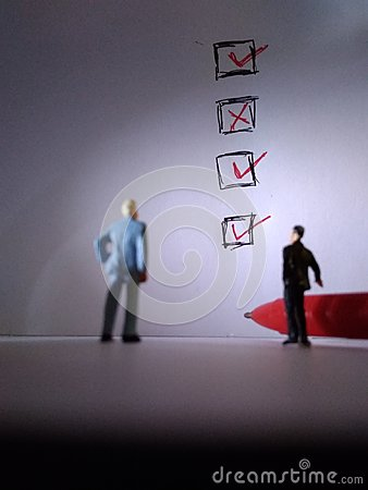 Free Two Standing Businessman Mini Figure Toys, Meeting, Check List Stock Images - 121161864
