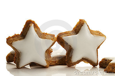Two standing star shaped cinnamon biscuits