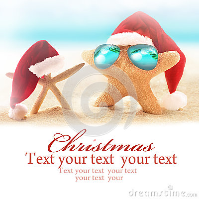 Free Two Starfish On Summer Beach And Santa Hat. Royalty Free Stock Photos - 77873368