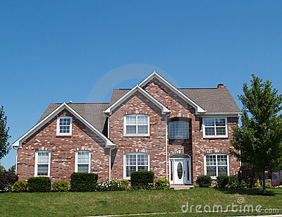 Two story new brick residential home stock photography for 2 story brick house plans