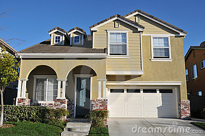 Two story single family house with driveway