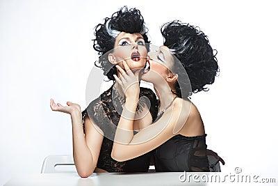 Two strange women posing
